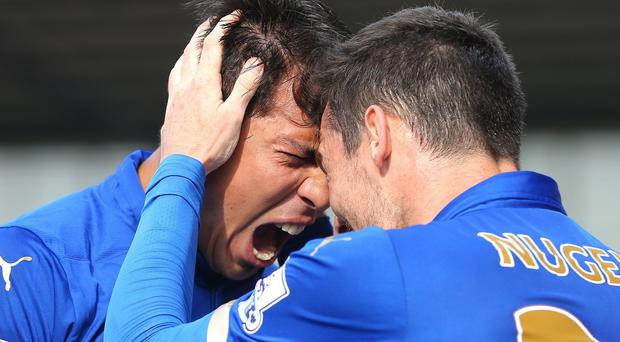 Leicester's Leonardo Ulloa (left) celebrates with team-mate David Nugent after scoring the winner against Stoke