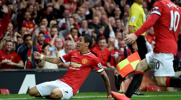 Debut delight: Angel di Maria celebrates his first goal in his first game at Old Trafford for Manchester United against QPR