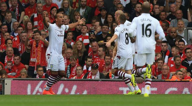 Gabby Agbonlahor's, left, first-half effort made the difference at Anfield