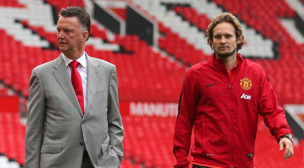 Daley Blind, right, thinks he can thrive working under Louis van Gaal, left