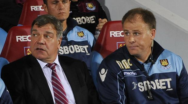 Neil McDonald, right, is sticking with Big Sam