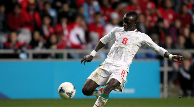 Sadio Mane has received his work permit and will join up with his Southampton team-mates on Friday
