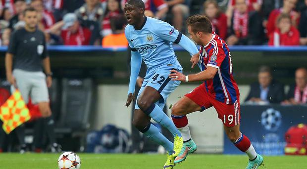 Manchester City manager Manuel Pellegrini has defended key midfielder Yaya Toure, pictured left, against criticism