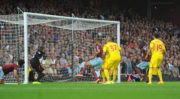 West Ham United's Winston Reid score their first goal during the Barclays Premier League match at Upton Park, London.