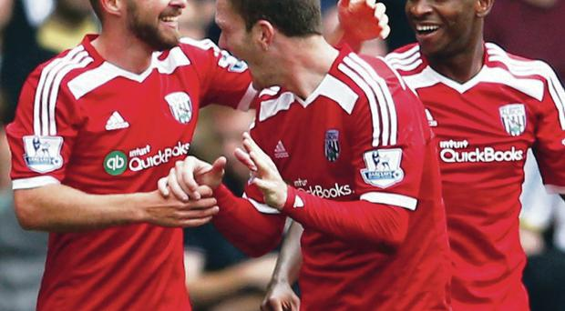 Get in: James Morrison (left) of West Brom celebrates with his teammates after scoring the winning goal against Spurs