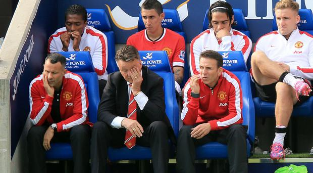 Louis van Gaal, centre, was fuming after defeat to Leicester