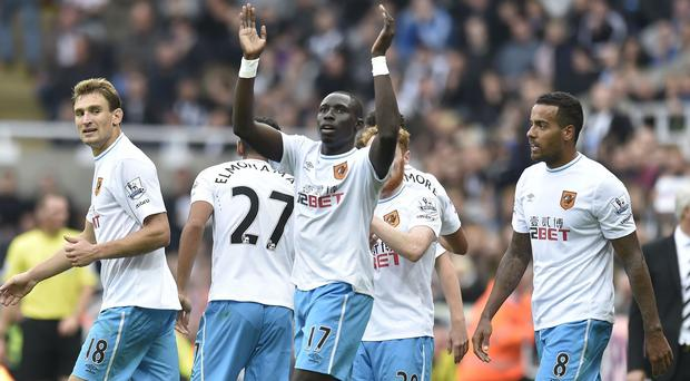 Hull's Mohammed Diame, centre, is glad to be back in his favoured central role