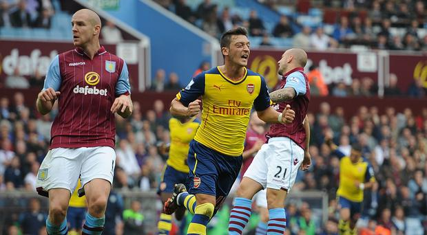 Arsenal midfielder Mesut Ozil, pictured centre, produced a fine display against Aston Villa