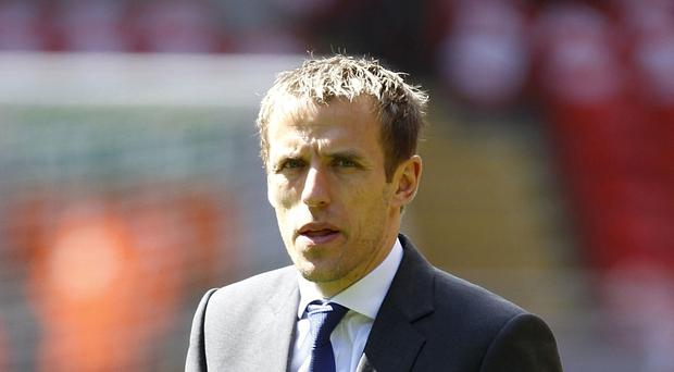 Phil Neville foresees further spending at Manchester United