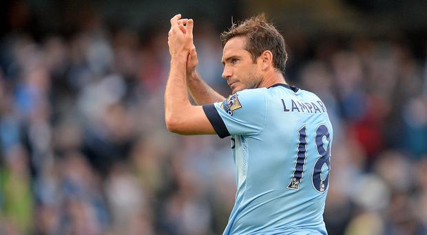 Manchester City's Frank Lampard applauds the fans after scoring against his old club Chelsea.