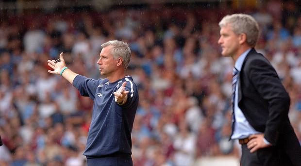 Mark Hughes, right, is ready to add to Alan Pardew's pain on Monday