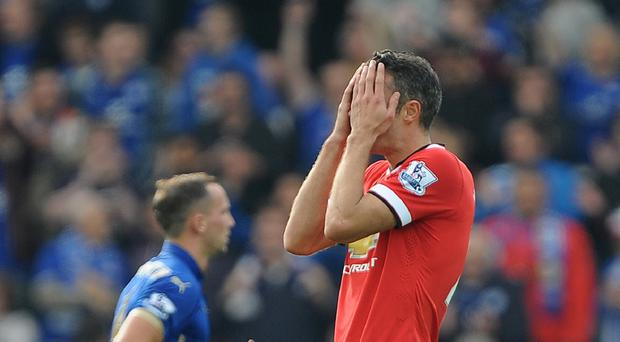 Robin van Persie shows his dejection after Leicester's fifth goal last weekend