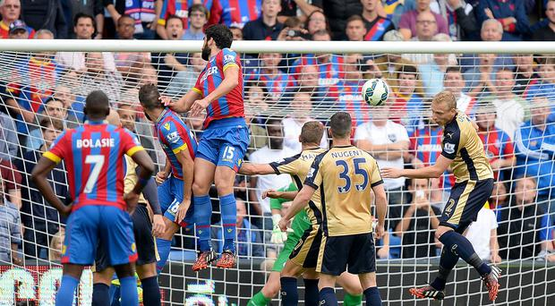 Crystal Palace's Mile Jedinak, third from left, scores his side's second goal