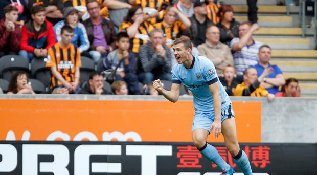 Manchester City's Edin Dzeko celebrates his second goal to make it 3-2