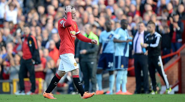 Wayne Rooney leaves the pitch after being sent off