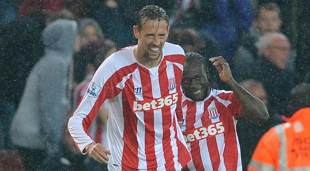 On-loan Chelsea winger Victor Moses, right, set up the winner scored by Peter Crouch, left, in Stoke's 1-0 victory over Newcastle.