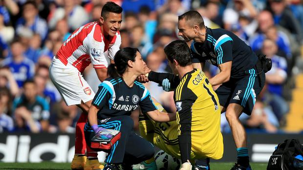 Eva Carneiro, centre left, has been backed over her treatment of Thibaut Courtois, centre right