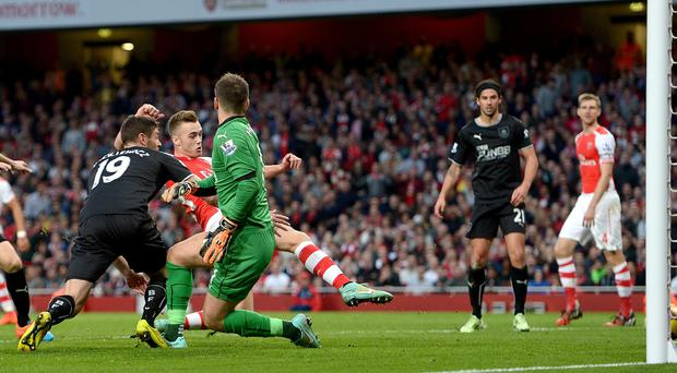 Arsenal's Calum Chambers scores his side's second goal of the game during the Barclays Premier League match at the Emirates Stadium, London.