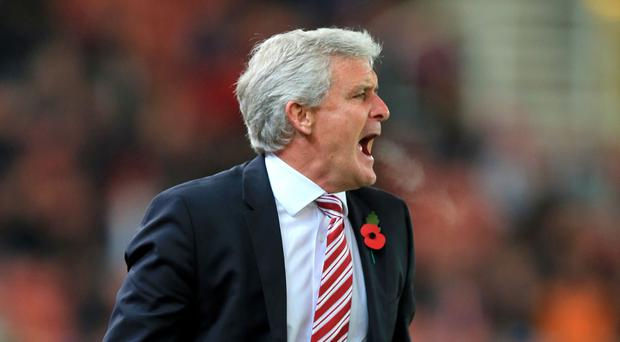 Mark Hughes, pictured, was left fuming after no action was taken against Alex Song for his tackle on Mame Biram Diouf