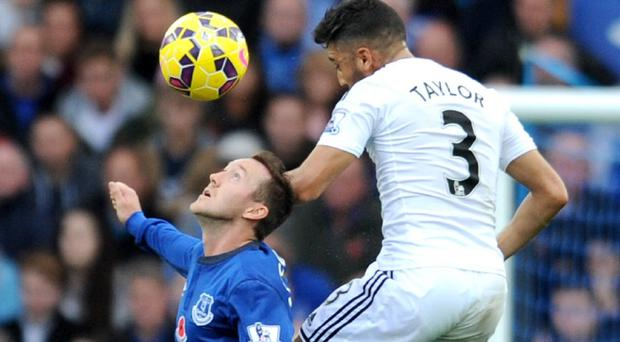 Neil Taylor, right, helped Swansea battle their way to a point at Goodison Park