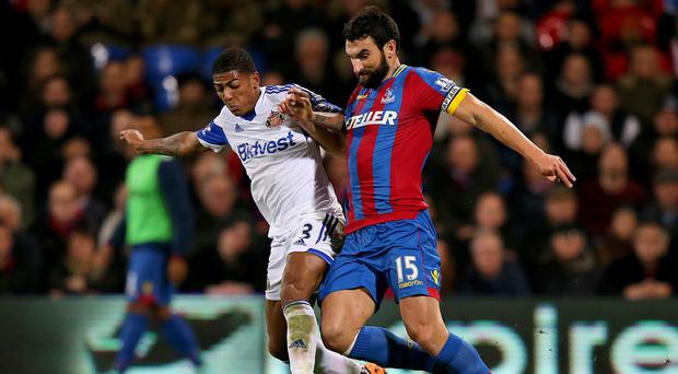 Mile Jedinak, right, was sent off in the 3-1 reverse to Sunderland on Monday night
