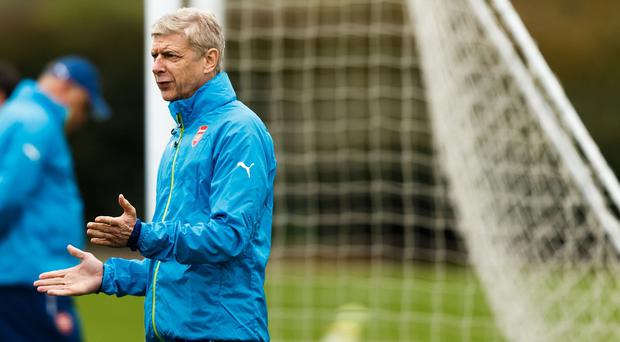 Arsene Wenger has questioned the role of UEFA's fifth officials