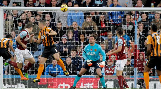 Burnley's Ashley Barnes, second from left, scores the winner against Hull City