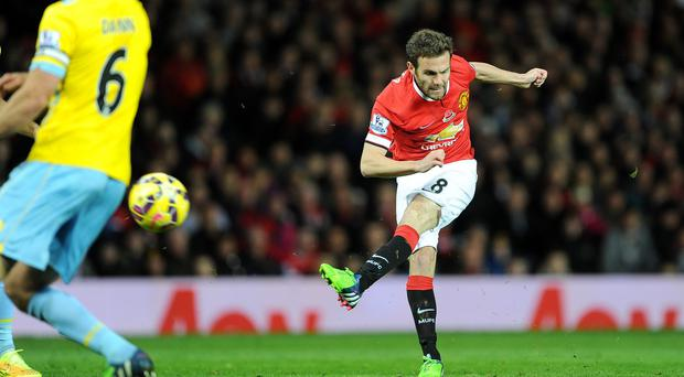 Manchester United's Juan Mata scores the winning goal against Crystal Palace