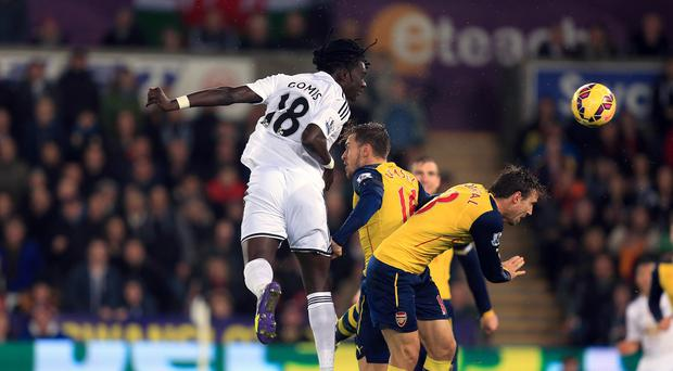 Bafetibis Gomis heads home the winning goal