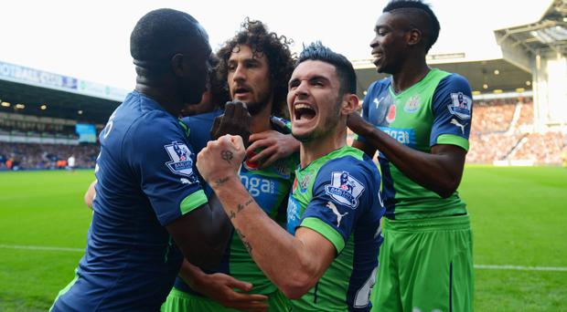 Head boy: Newcastle players celebrate after Fabricio Coloccini heads their second goal against West Brom