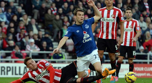 Brought down: Conor Wickham fouls Seamus Coleman to concede a penalty, which Leighton Baines converted