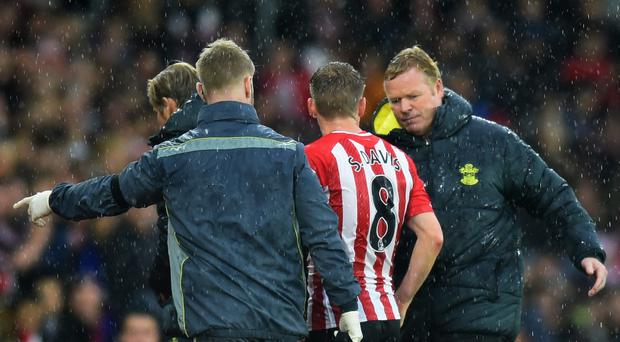Rolling on: Ronald Koeman congratulates Steven Davis as Southampton notch their 11th victory in 12 games