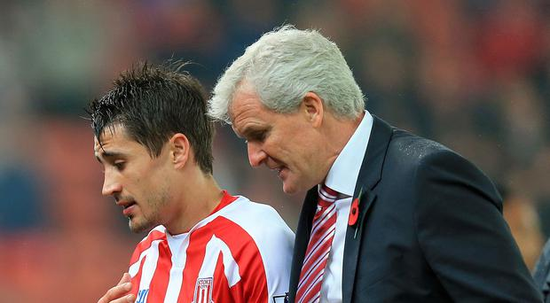 Manager Mark Hughes, right, is happy to see Bojan Krkic's, left, rise in form at Stoke