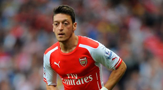 Mesut Ozil has returned for Arsenal after a serious knee injury