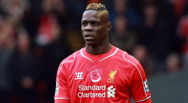 Liverpool striker Mario Balotelli insists he is working harder than ever
