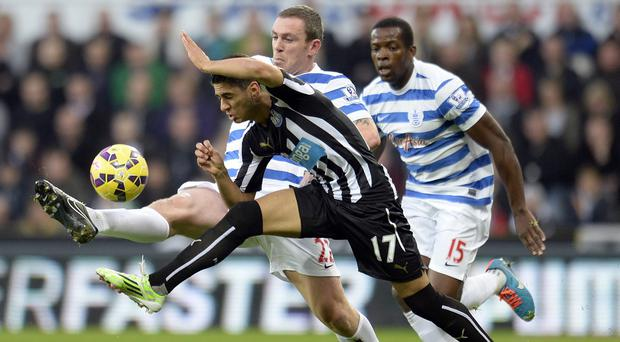 Ayoze Perez, number 17, and Richard Dunne battle for the ball at St James' Park