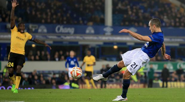 Leon Osman scores Everton's first goal of the game against West Ham