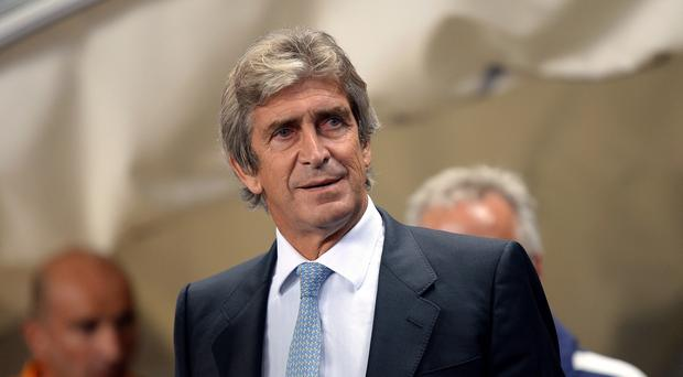 Manchester City boss Manuel Pellegrini, pictured, was pleased with Yaya Toure's character