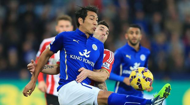 Leicester's Leonardo Ulloa (front) battles with Sunderland's Anthony Reveillere but failed to make an impact on Saturday.