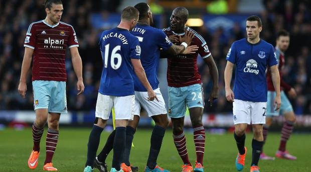 Stand-off: Sylvain Distin of Everton holds back Carlton Cole of West Ham United during Saturday's clash at Goodison Park