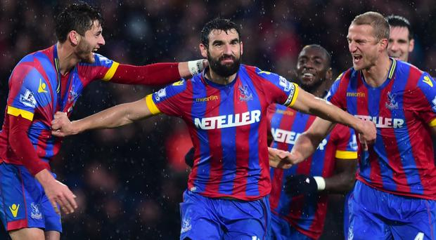 Mile Jedinak, pictured centre, hopes the Liverpool win will boost morale at Selhurst Park