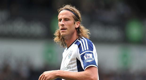 Jonas Olsson, pictured, will not feature again until January