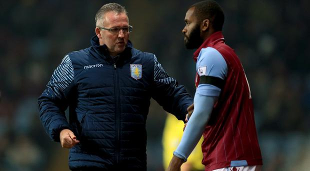 Paul Lambert, left, has not started Darren Bent, right, in any Premier League games this season