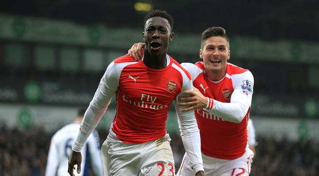 Arsenal's Danny Welbeck ,left, celebrates scoring the opening goal