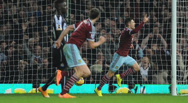 West Ham's Aaron Cresswell, right, celebrates scoring the opener against Newcastle
