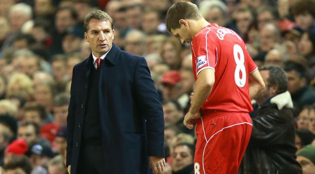 Liverpool captain Steven Gerrard, right, has dismissed talk of tension with manager Brendan Rodgers, left
