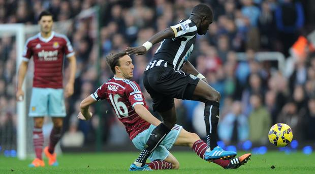 Midfielder Mark Noble (left) made a club-record 205th Premier League appearance in the 1-0 win over Newcastle.