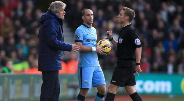 Mike Jones, right, angered Manchester City by failing to award Sergio Aguero a clear penalty at Southampton, booking the striker instead