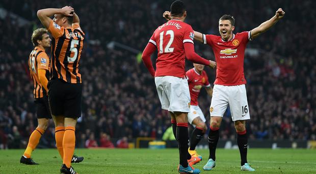 Michael Carrick, right, has backed Manchester United team-mate Robin van Persie to get back to his best