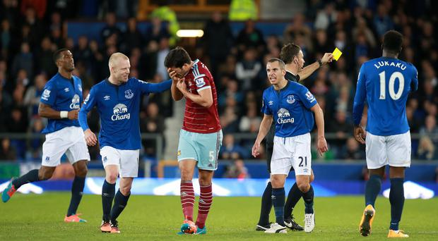 James Tomkins, centre, is embarrassed by his theatrics against Everton which saw Kevin Mirallas, not pictured, booked